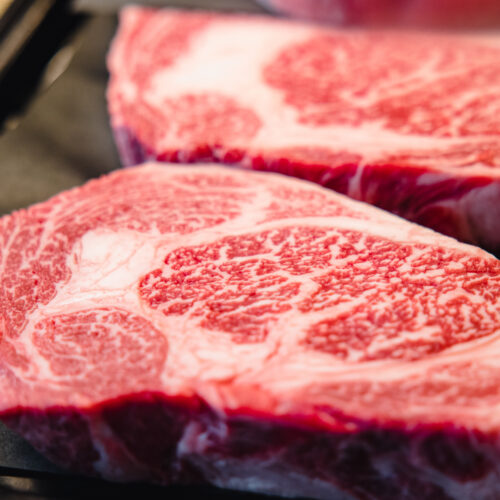 sliced meat on black plate