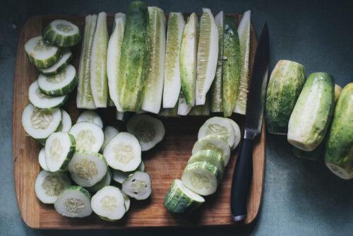 cucumbers beside silver knife