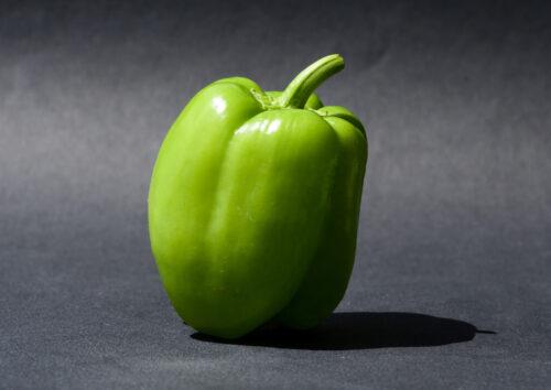 green bell pepper on black textile